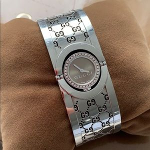 Gucci Stainless Still Watch adorned with Diamonds